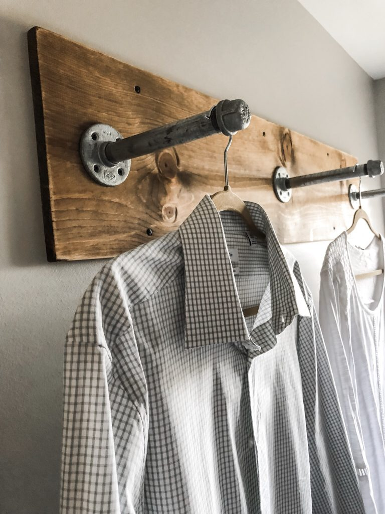 A small wall mounted DIY clothes rack for the laundry room .