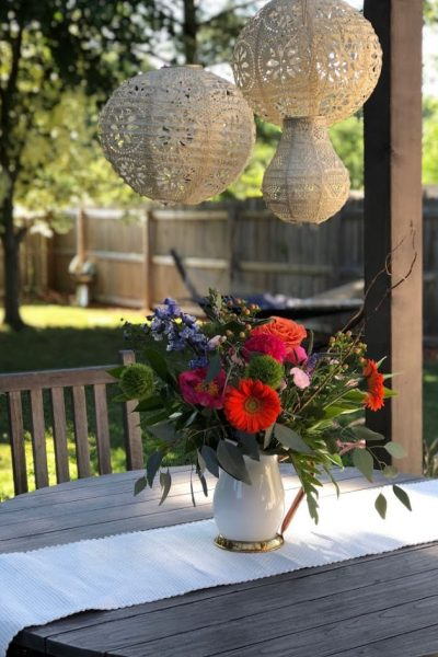 Back porch with beautiful DIY lanterns