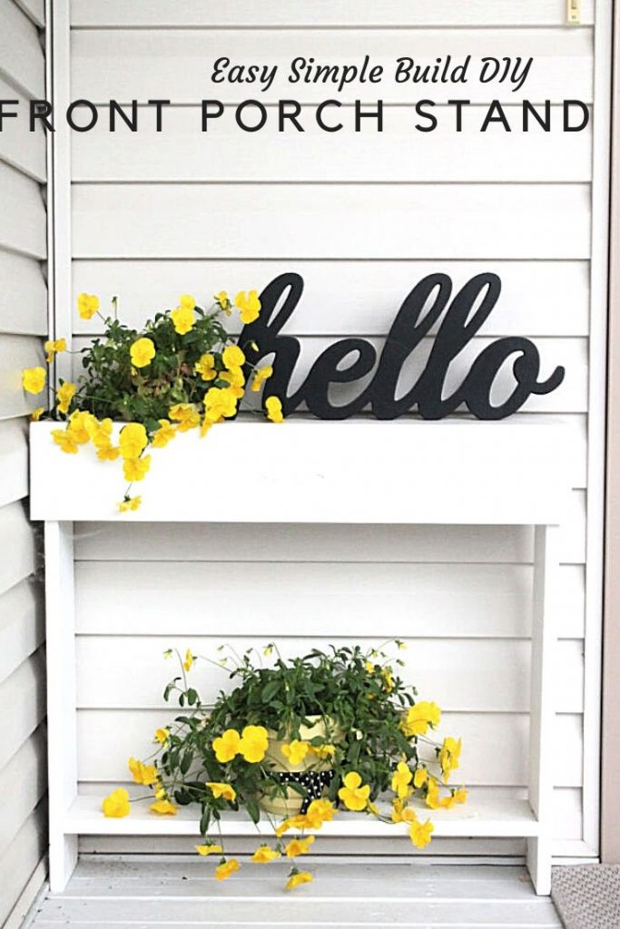 A small DIY Front Porch Table pained white with yellow pansies and the word hello.