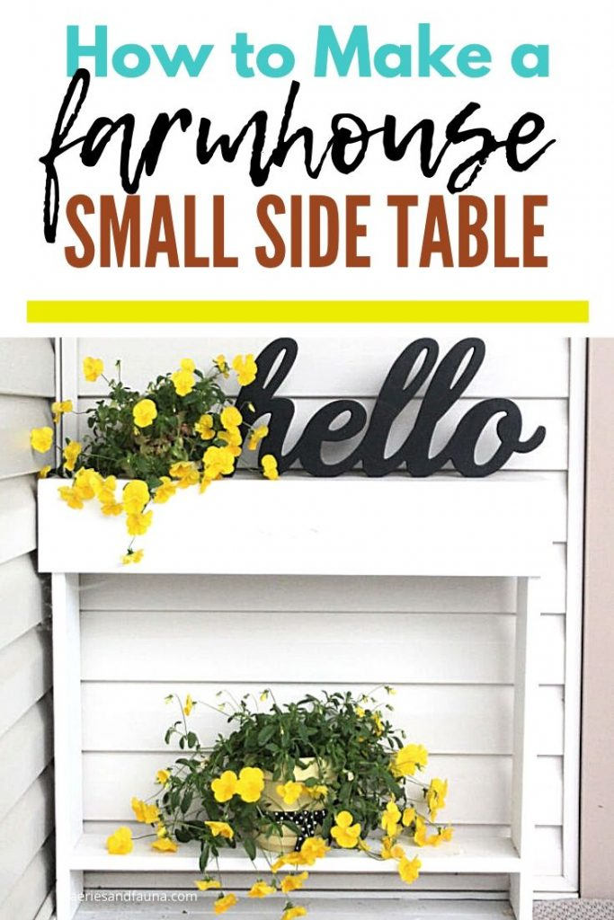 A white painted handmade side table with yellow pansies, and flower pots.