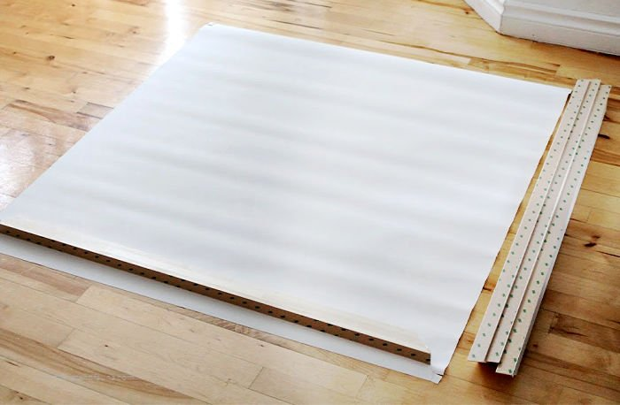 A large canvas print from Photowall, laying on a flat surface with the frame before assembly. Some wrinkles are showing as the canvas print has not been stretched.