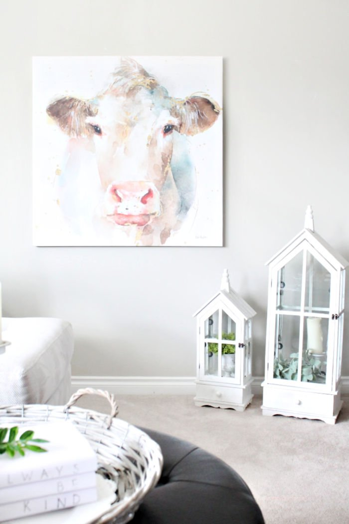A modern farmhouse canvas print wall art. The picture is a watercolour cow in pretty feminine soft colours.