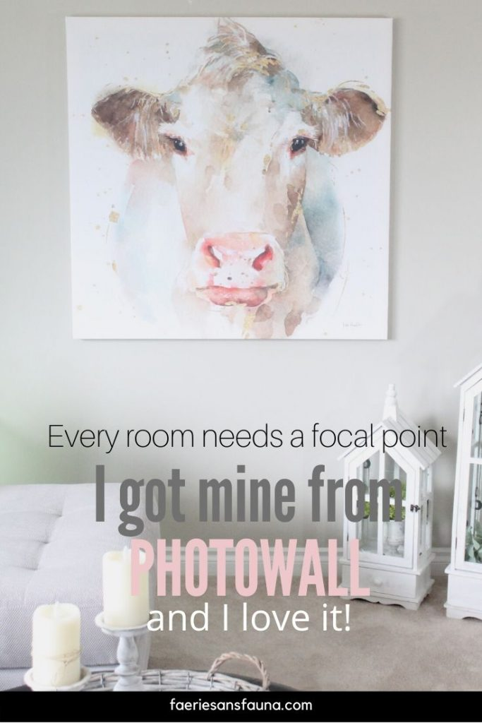 A large watercolour canvas print from Photowall, of a pretty cow face in soft pastel colours.