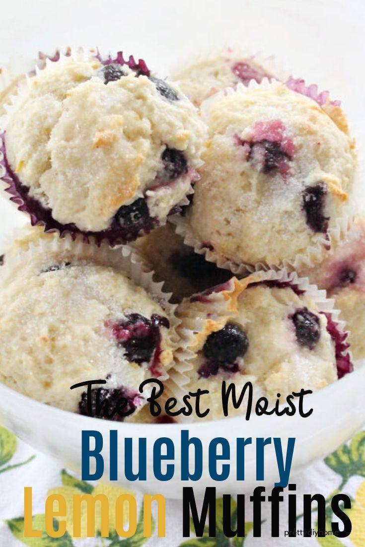 A bowl of moist blueberry lemon muffins with a light white sugar streusel topping.