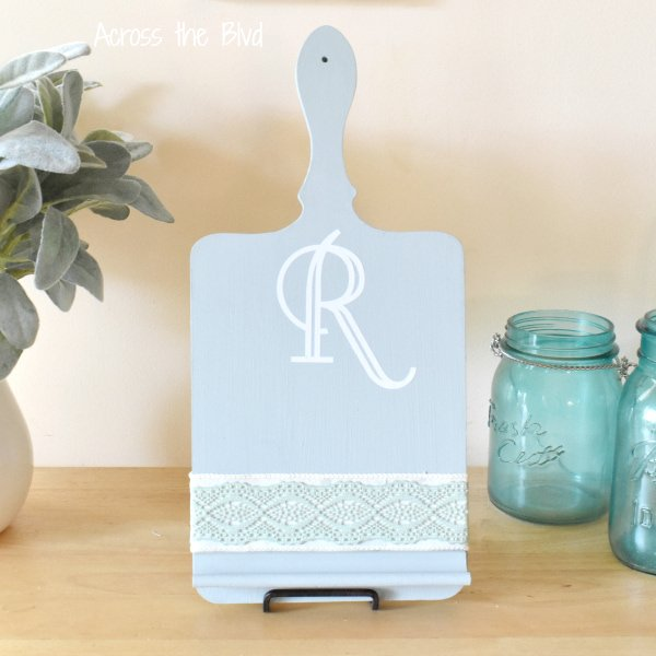 Recipe Holder cutting board painted soft blue with greenery and pretty turquoise antique mason jars.