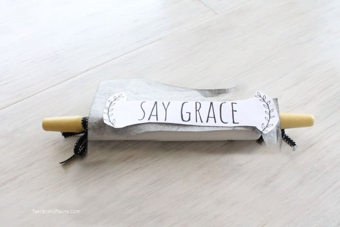 A painted vintage rolling pin cover with carbon paper and a free printable sign pattern.