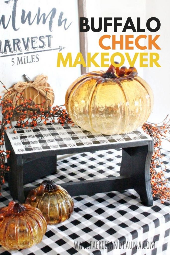 A Fall arrangement created with orange glass pumpkins and a vintage stool refinished in buffalo check.