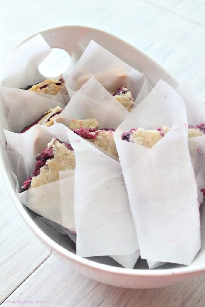 From scratch bumbleberry slab pie cut into finger size and wrapped in parchment for serving.