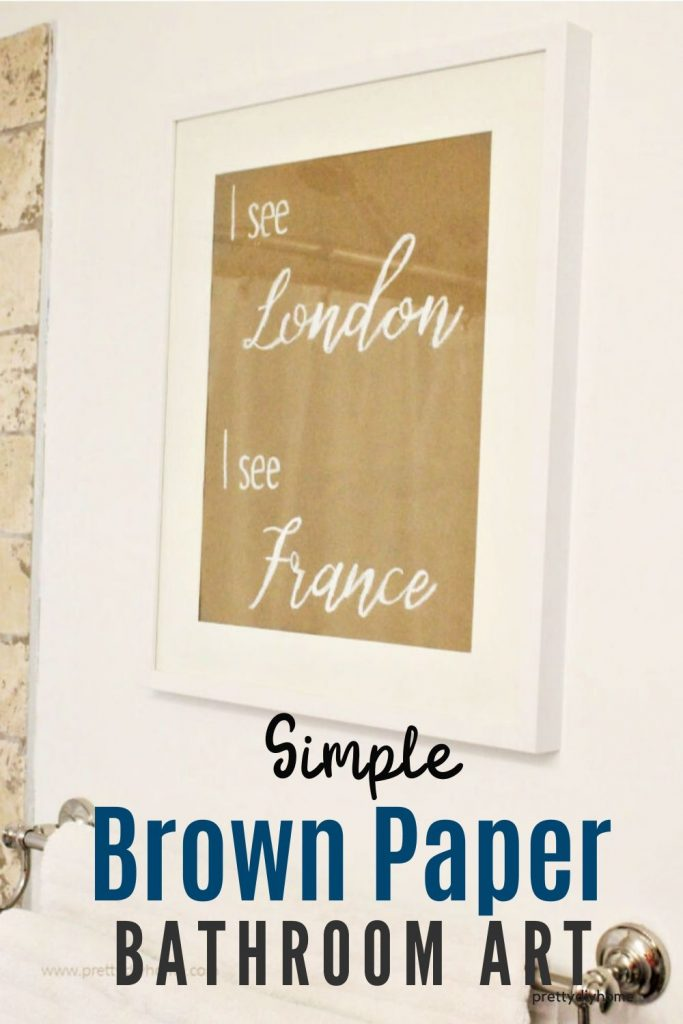 Simple brown paper sign wall art for a bathroom.
