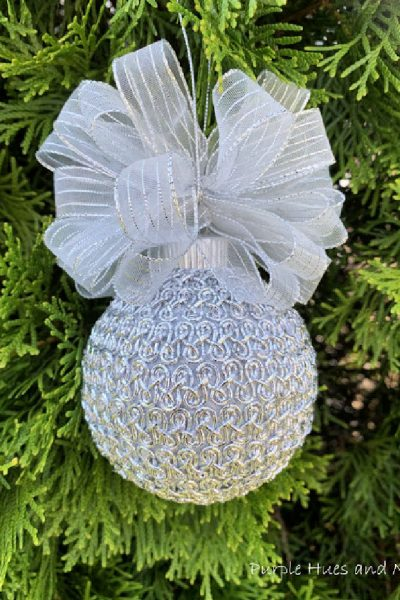 DIY very feminine DIY Christmas ornament in sparkly silver trim with a large ribbon.