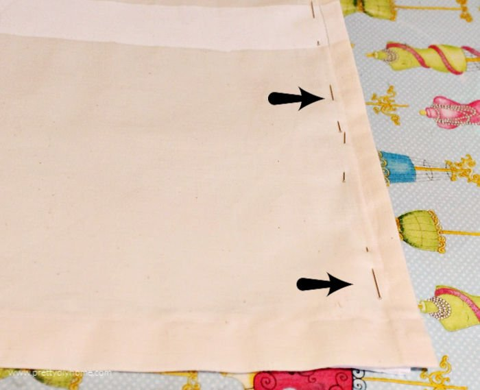 A picture showing the pin placement for sewing the edge of a muslin to the edge of a inexpensive shower curtain.