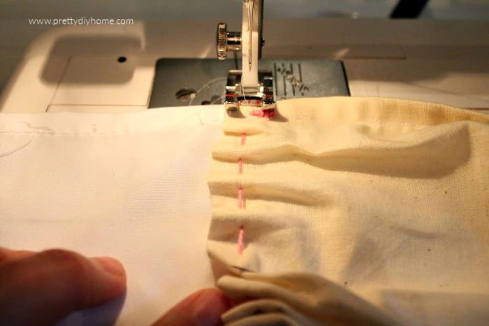 Sewing even folds on a fill using a sewing machine while making a DIY farmhouse shower curtain.