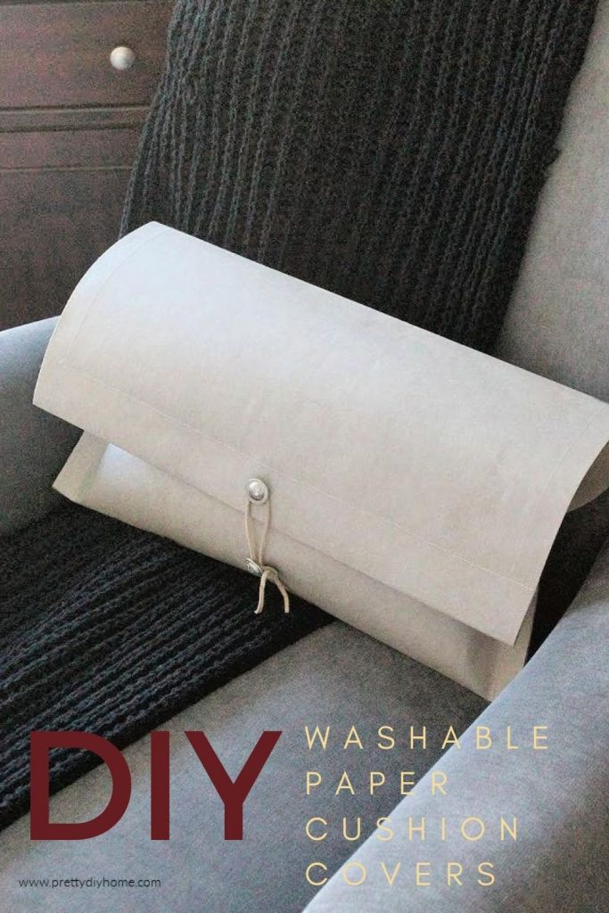 Simple and classic DIY cushion cover made in stone coloured washable paper with silver button closure.