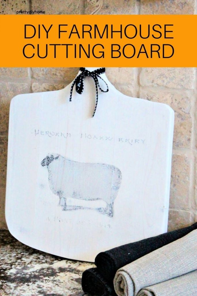 Handmade cutting board with farmhouse graphic.