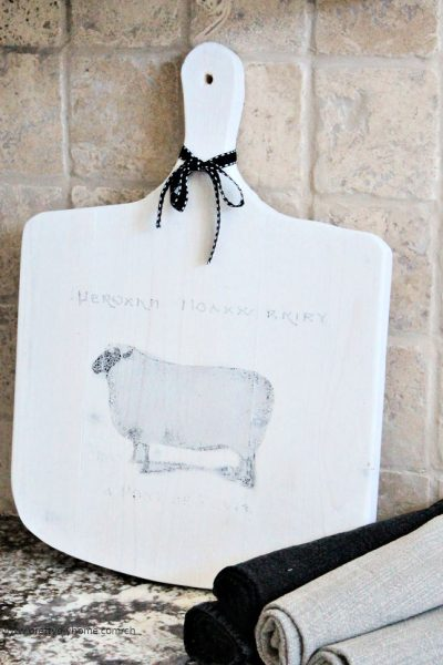 DIY Cutting board in white with a french farmhouse graphic sheep on the front.