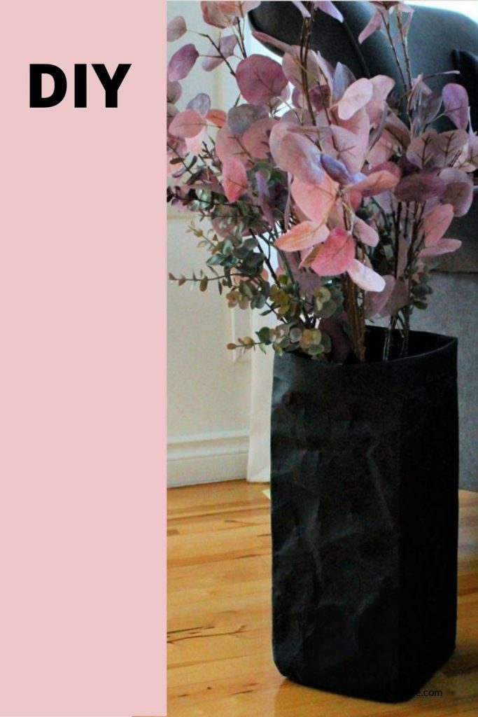 Floor size flower vase made using a washable paper bag.