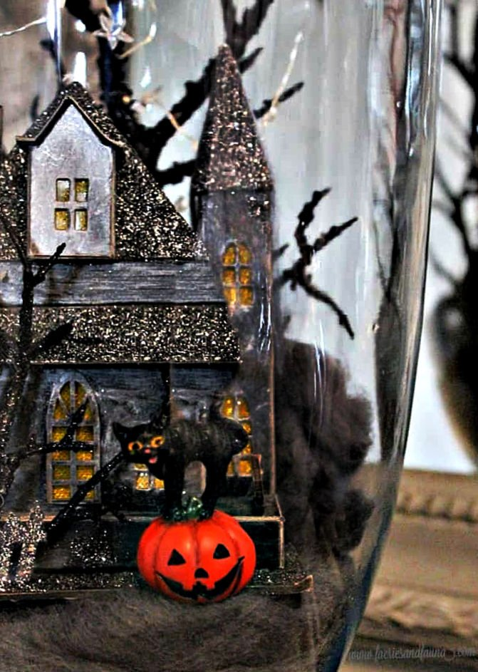 A Haunted house Halloween Diorama with a black cat and jack-o-lantern.