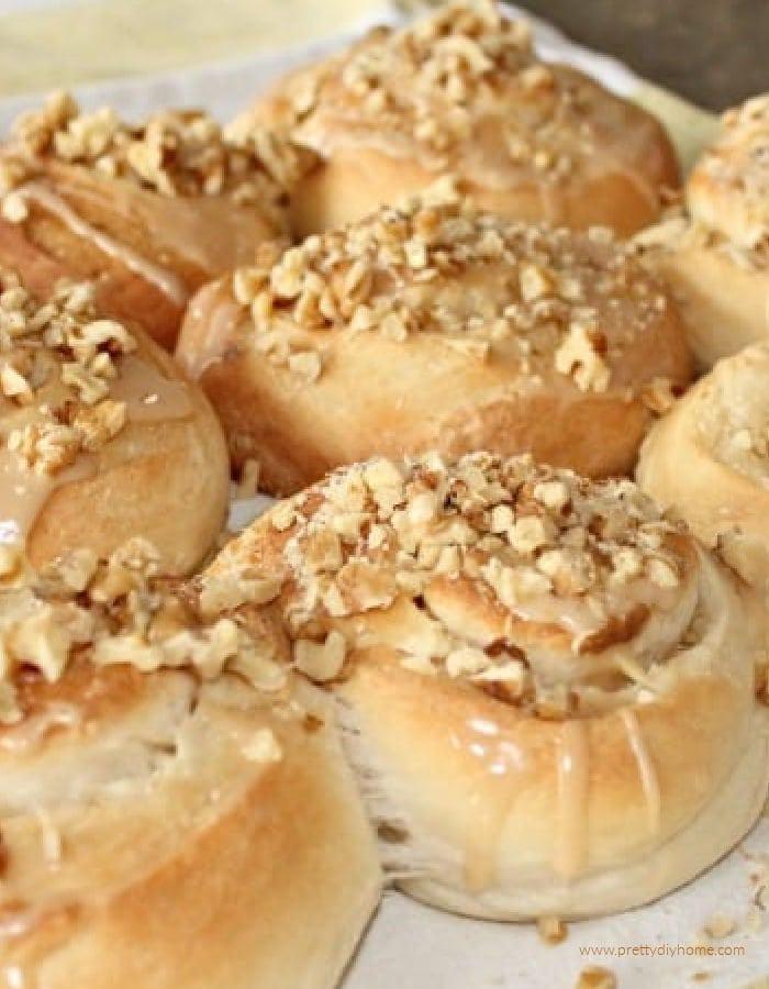 Homemade butterhorn rolls recipe covered in glaze and walnuts.
