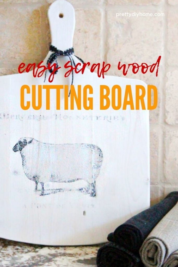 A DIY cutting board made using scrap wood in white with a french sheep graphic.