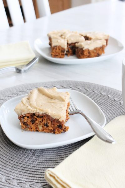 Moist tomato soup cake with raisins, walnuts and brown sugar icing.
