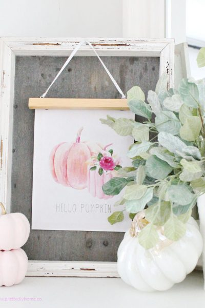 A farmhouse DIY pink pumpkin printable with pink and white pumpkins and greenery for Fall.