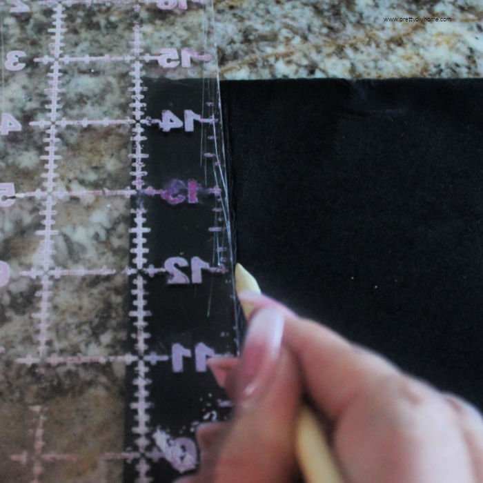 Scoring the inside of a folding washable paper