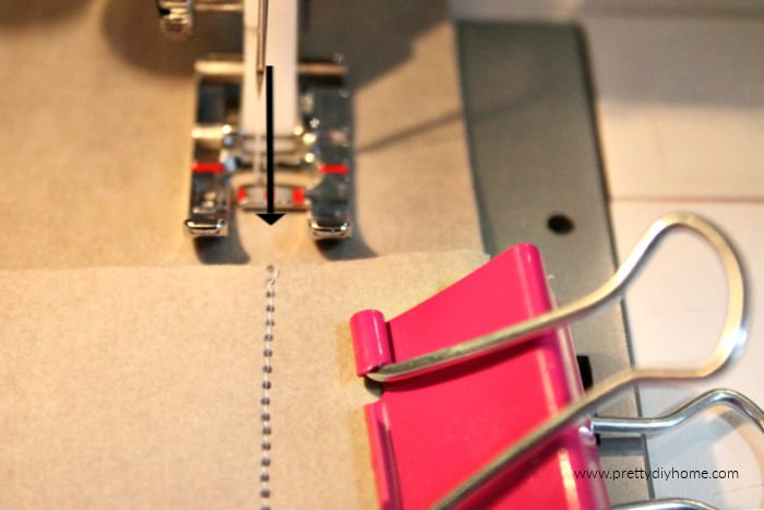 Making a DIY cushion cover using washable paper, showing the seam