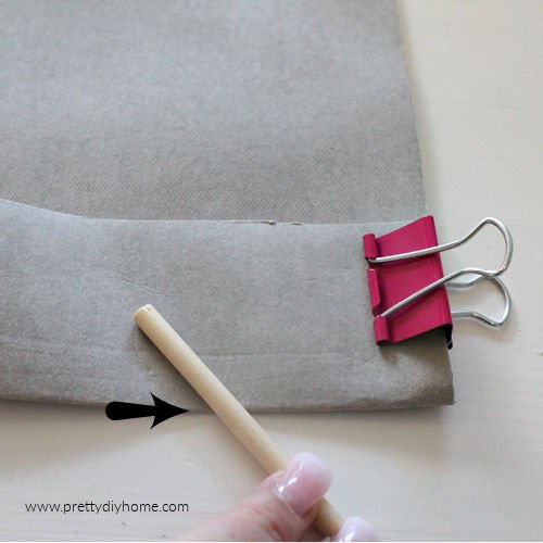 Folding and pressure creasing kraft tex washable paper for making a DIY cushion cover.