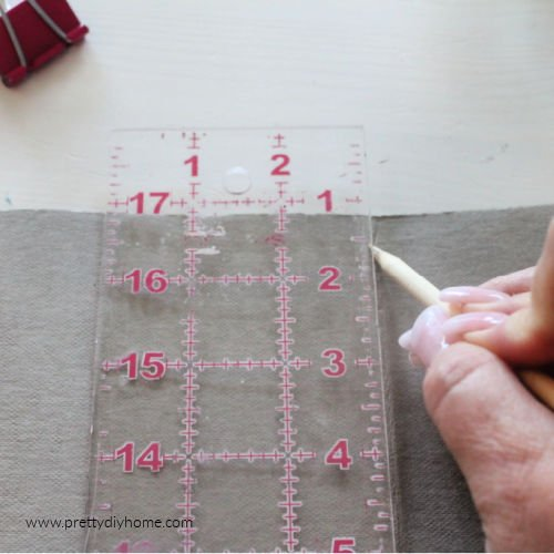 Using a pointed stick to crease the inside of a fold using washable paper.