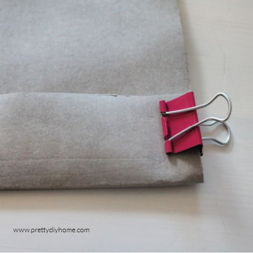 Folding washable paper over and holding in place with an alligator clip