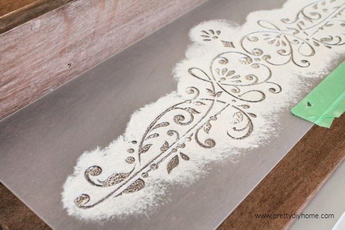 Applying a prima stencil to a DIY farmhouse shelf for the bathroom