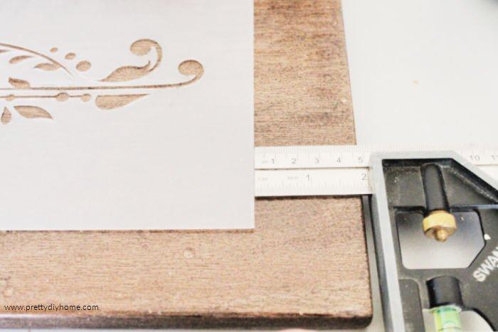 Centering a stencil onto a DIY Farmhouse shelf