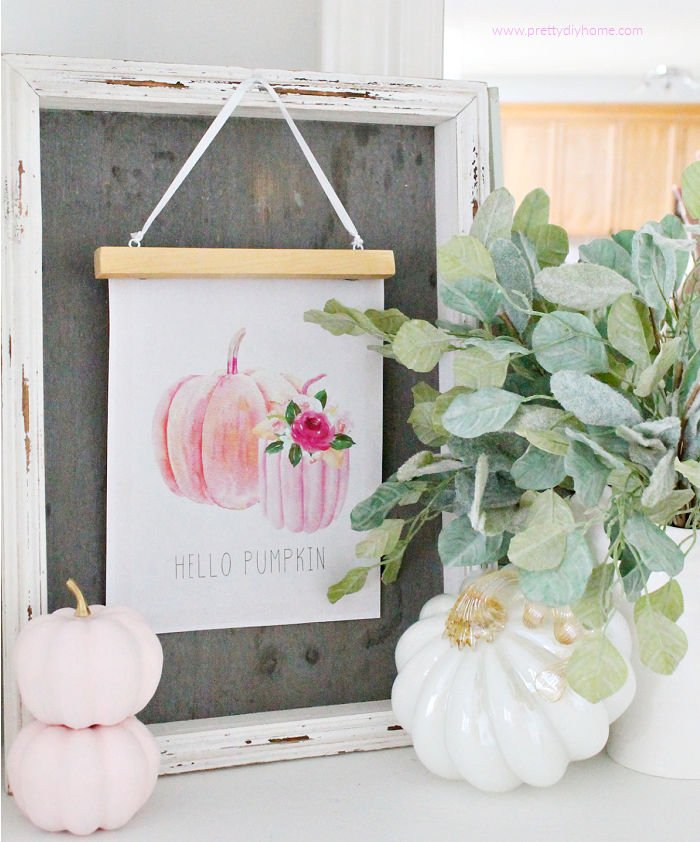 Easy and Inexpensive Neutral Fall Decor with a Free pumpkin printable, diy wood hanger, and white pumpkins.