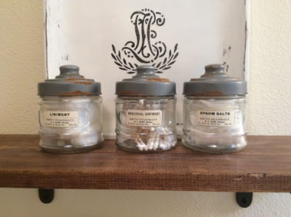 Faux antique jars for the bathroom on a shelf with vintage looking labels.