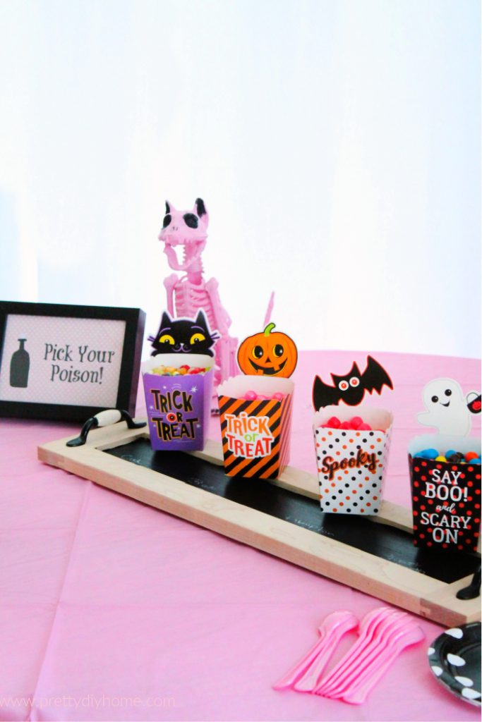 A Pink Halloween Party candy serving idea with a DIY chalkboard tray, and free printable Halloween signs