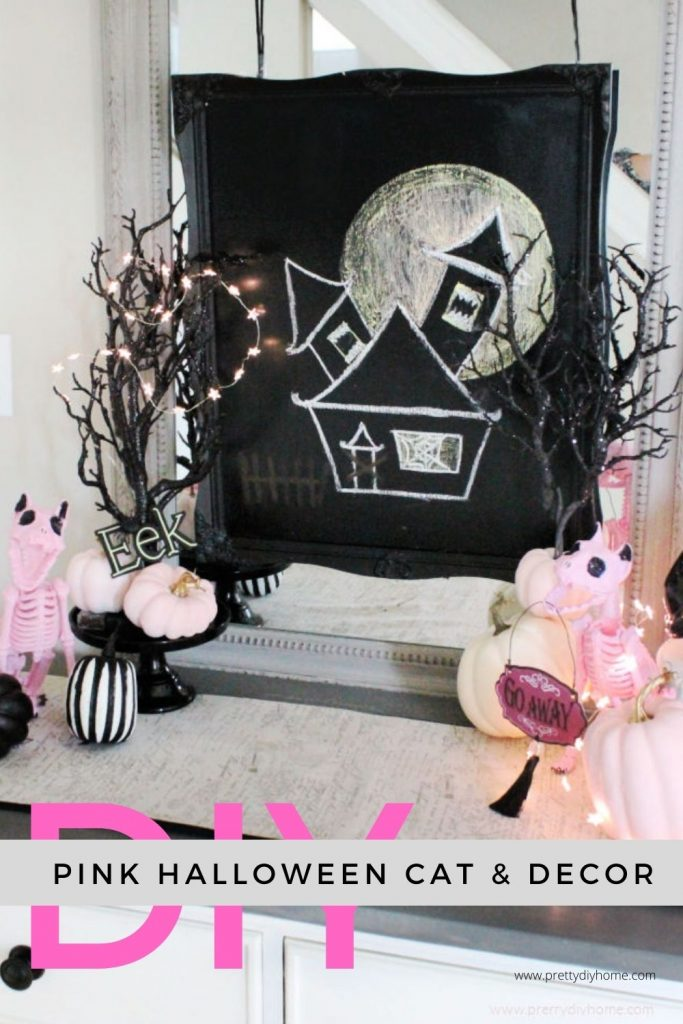 Pink Halloween Decorations with Pink Cats, Black Pumpkins and a DIY chalkboard haunted house.