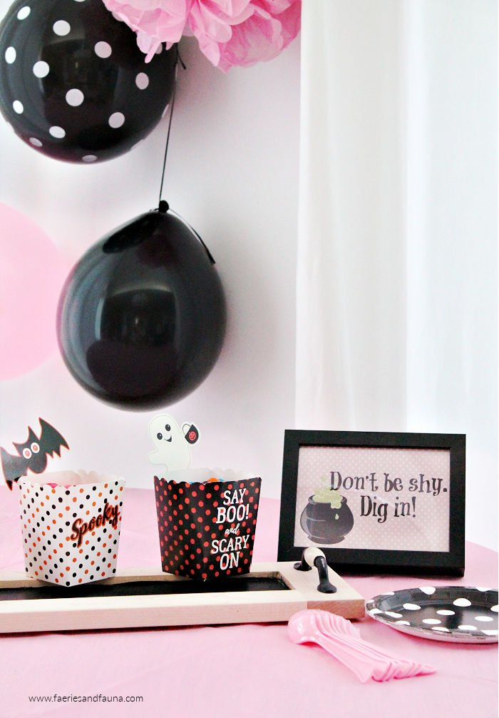Pink Halloween Candy Buffet and table decor with black and pink balloons.