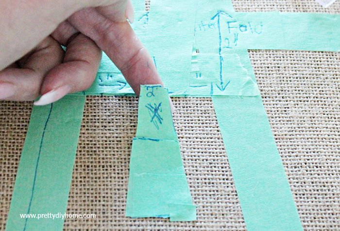 Removing excess tape from a letter A stencil