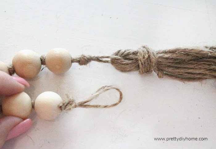 Making the loop on the end of a farmhouse bead garland.