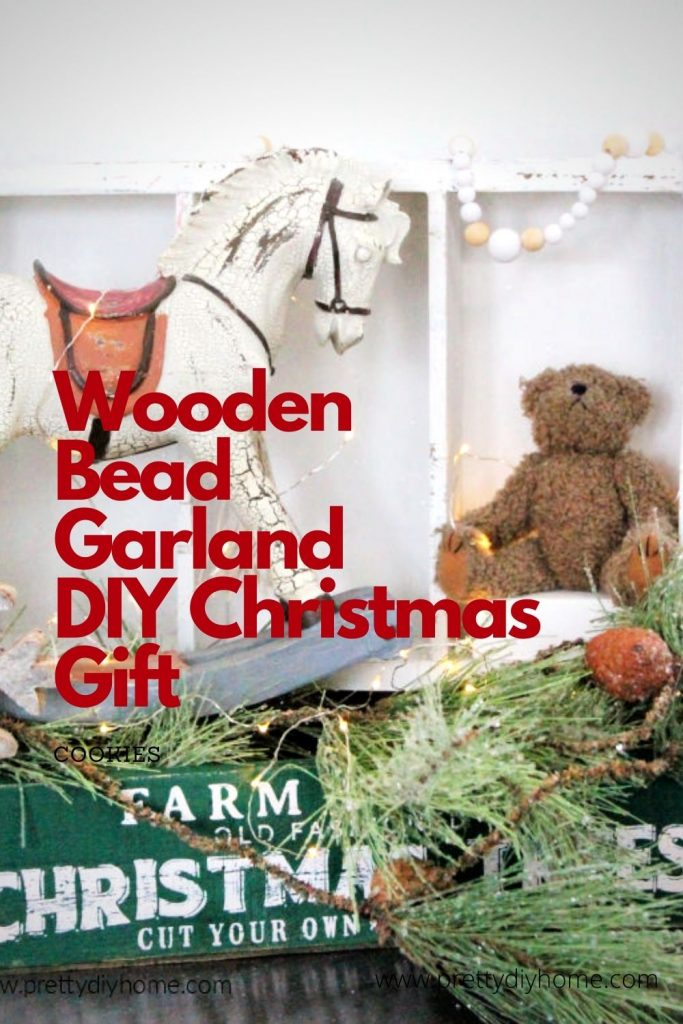 A Christmas vignette with a DIY Farmhouse Wooden Bead Garland in a Christmas display.