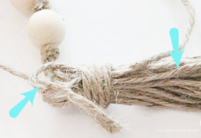 Making the loops for tying a tassel on a DIY Christmas Gift idea