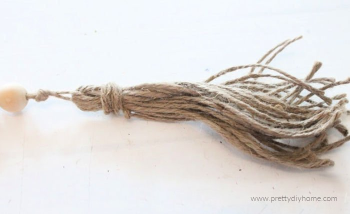 A small tassle for the end of a DIY wooden farmhouse bead garland.