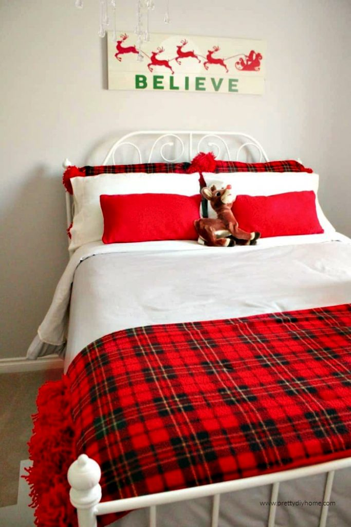 Child's bedroom decorated for Christmas in Tartan plaid and reindeer.