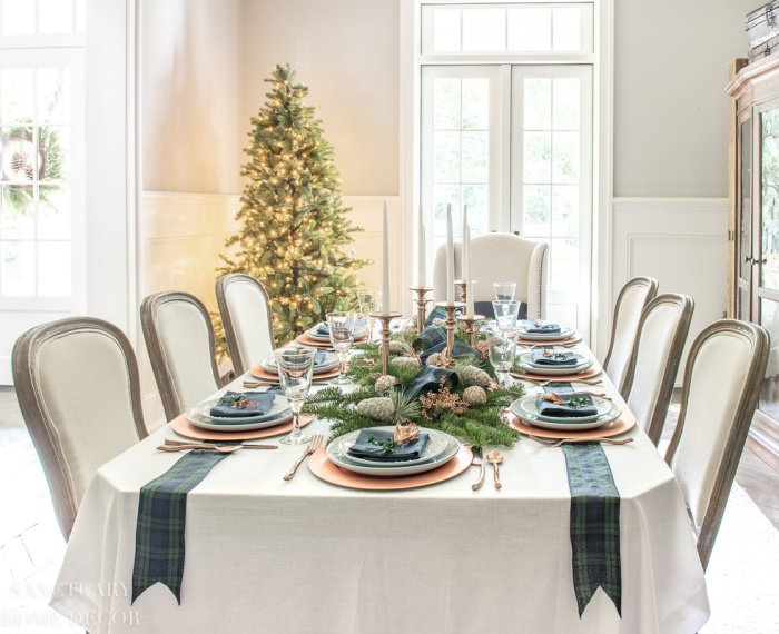 Formal Christmas Table decorated with Blue and Green Tartan Plaid.  Christmas tree in background and wainscotting.