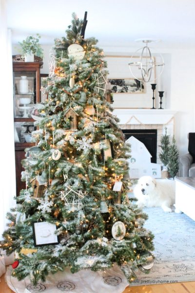 Large Christmas tree decorated in neutral colours in a farmhouse Christmas living room.