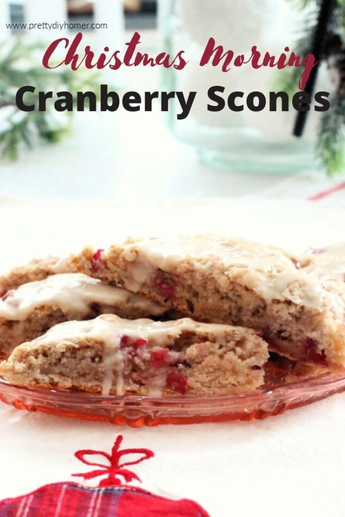 fresh cranberry scones with vanilla glaze served on a depression glass pink plat for Christmas morning breakfast.