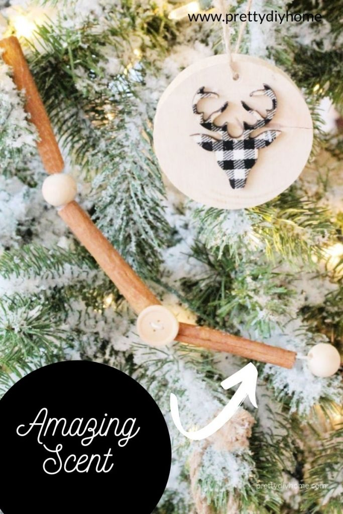Cinnamon scented DIY cinnamon stick garland hanging on a Christmas tree decorated with rustic farmhouse decorations.