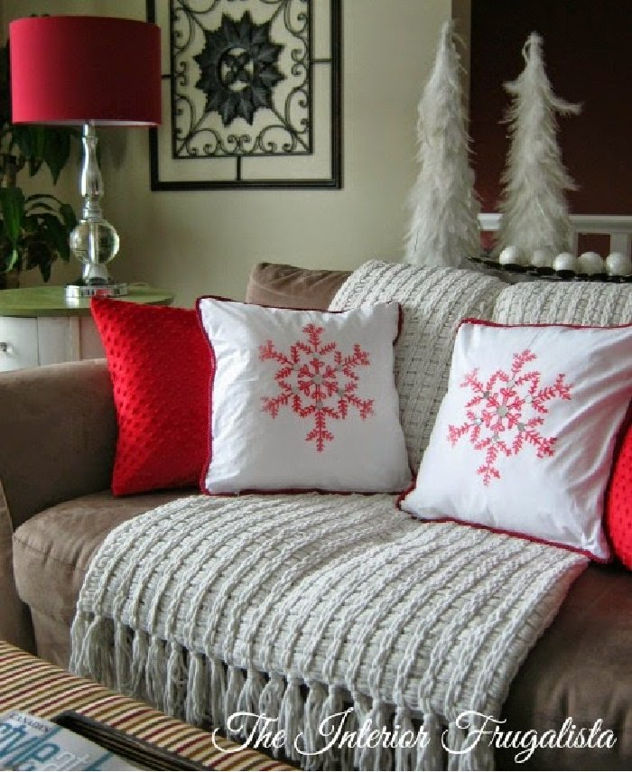 Traditional Christmas cushion in white with a red snowflake.