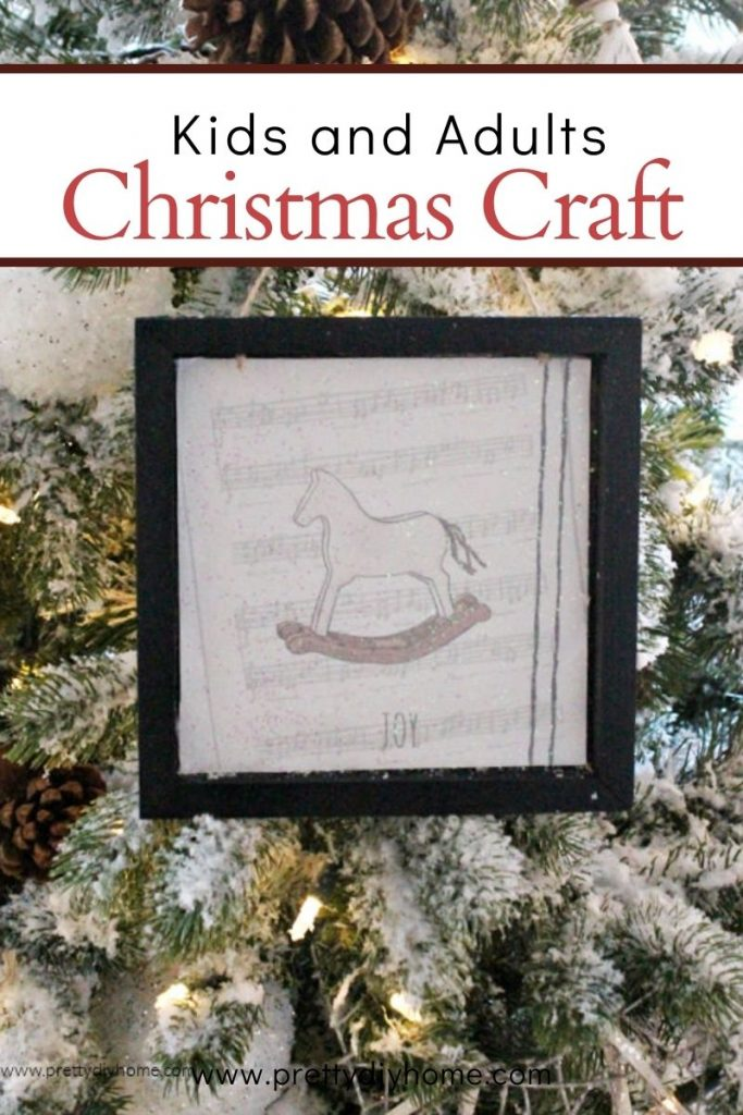 Christmas craft made for the Christmas tree with a black frame and rocking horse image.