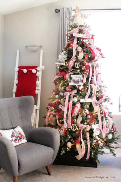 Farmhouse Christmas Tree with lots of red ribbon